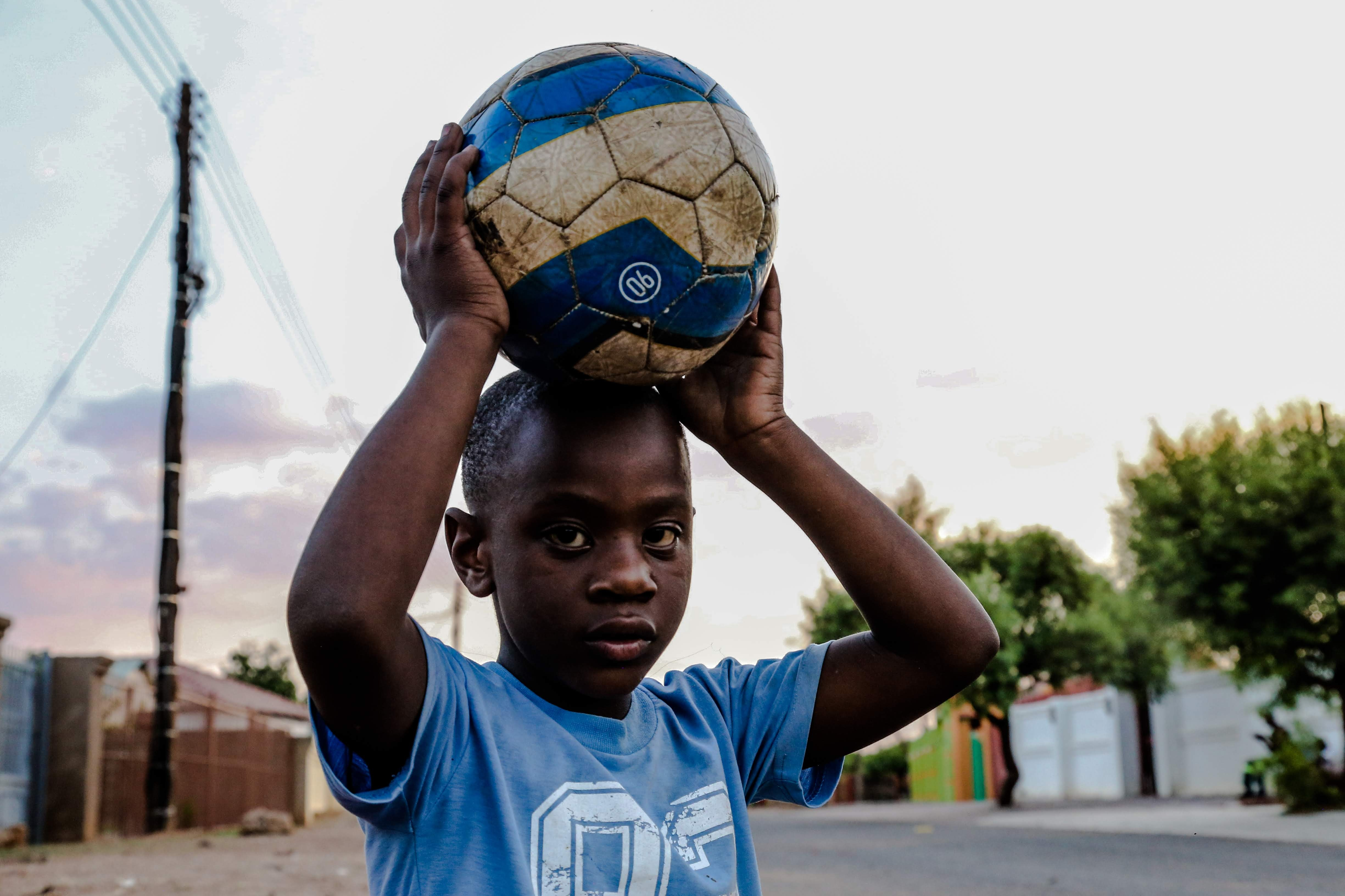 boy-carrying-soccer-ball-on-his-head-1866654